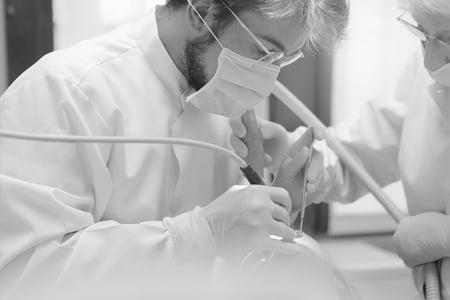 Surgeon in PPE pexels-andrea-piacquadio-3779701-bw-1